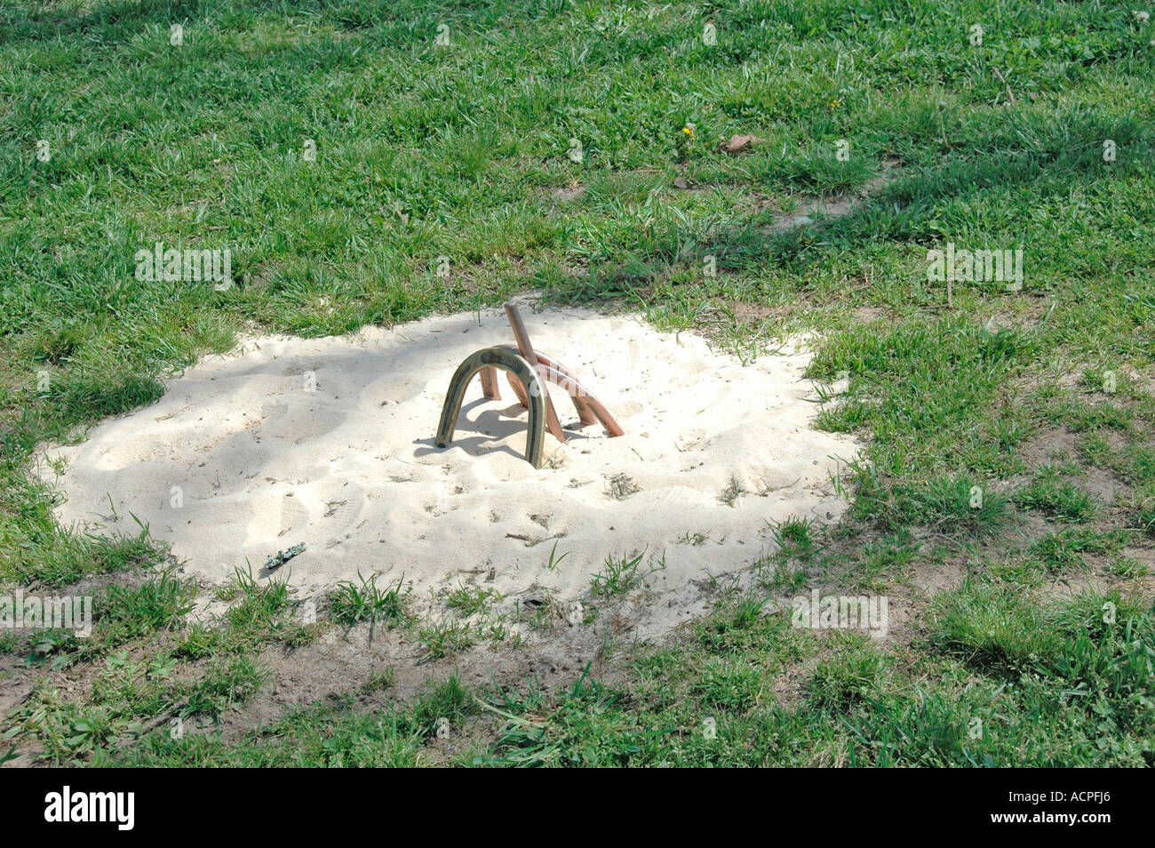 horseshoe pit and shoes for game at dude ranch made in backyard of
