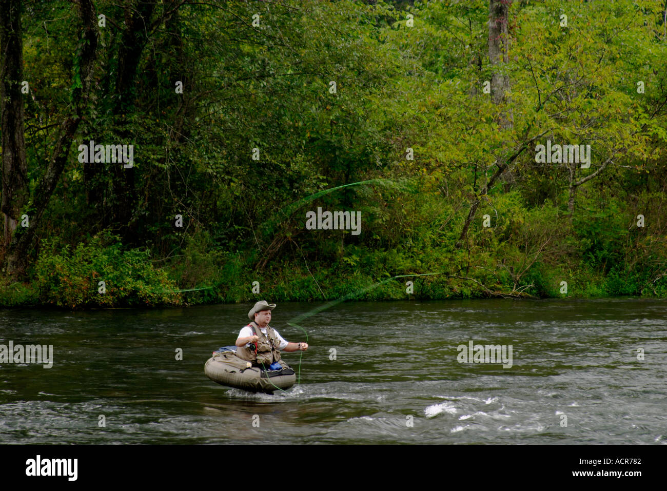 Fly fisherman in float tube trout fishing the hiwassee for Best fishing float tube
