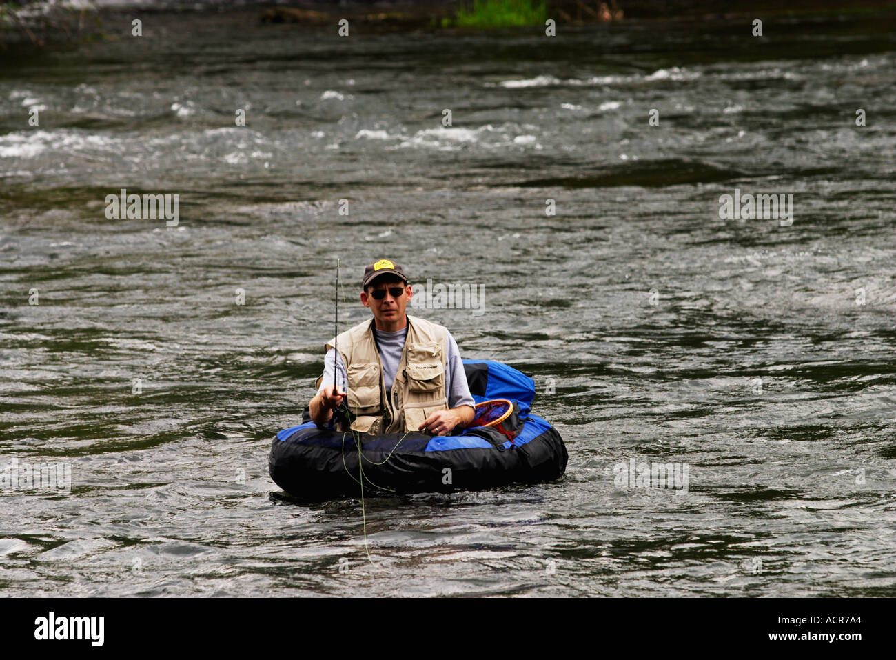Fly fisherman in float tube trout fishing the hiwassee for Fly fishing float tube