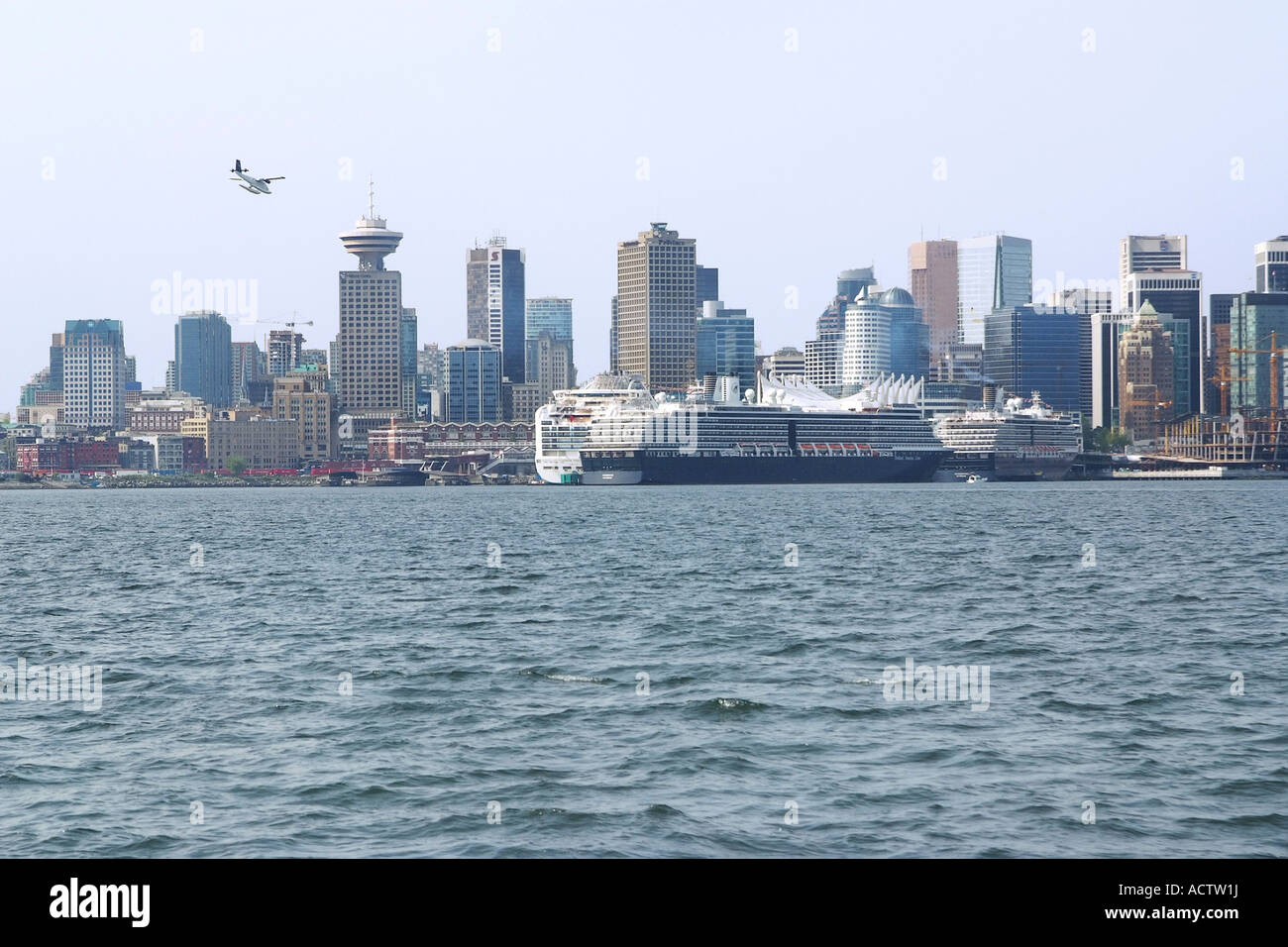 VIEW OF CANADA PLACE PIERS DOWNTOWN VANCOUVER FROM SEA SIDE - Cruise ship jumper
