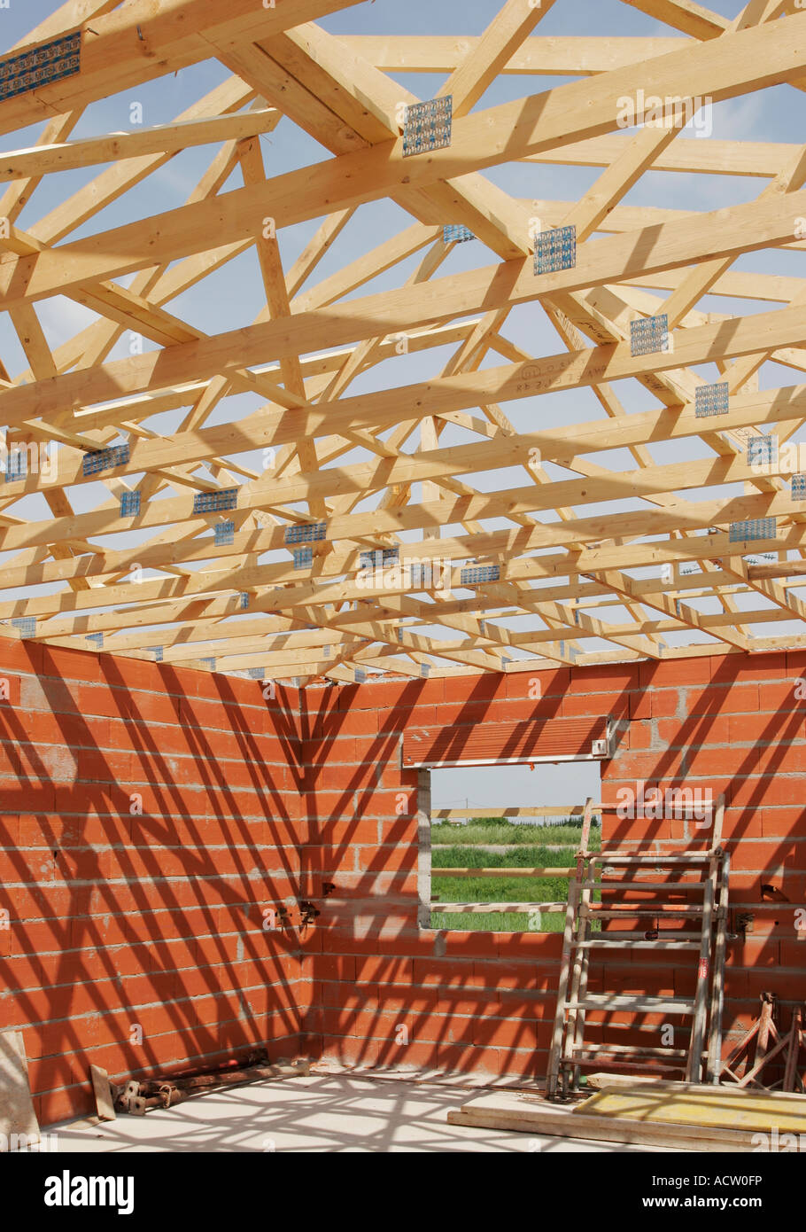 wooden a frame roof truss construction on a small house stock stock photo wooden a frame roof truss construction on a small house