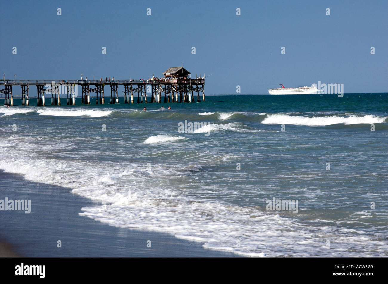 The cocoa beach florida pier with cruise ship and waves for Cocoa beach pier fishing