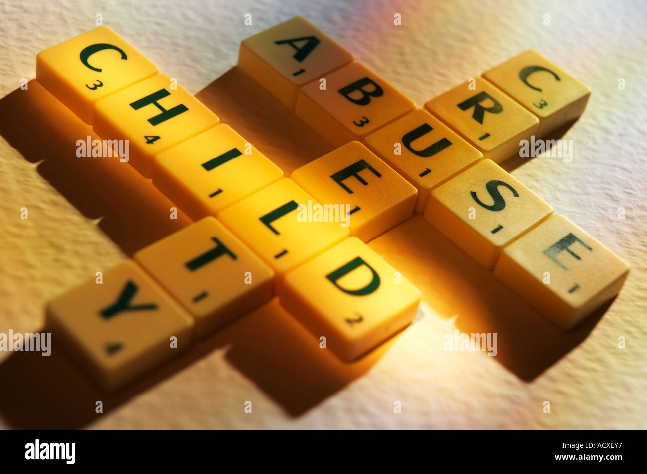Worksheet Child Spelling scrabble board game letters spelling the words child abuse cruelty cruelty
