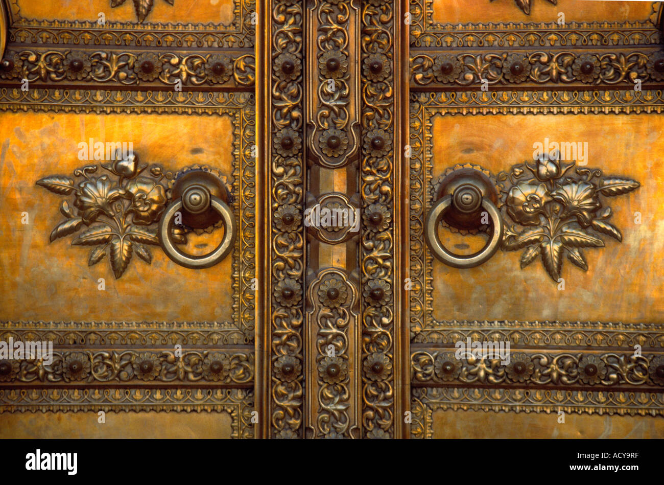 A GOLDEN DOOR with FLORAL DESIGNS at the entrance to the CITY PALACE in JAIPUR RAJASTHAN INDIA & A GOLDEN DOOR with FLORAL DESIGNS at the entrance to the CITY ... Pezcame.Com