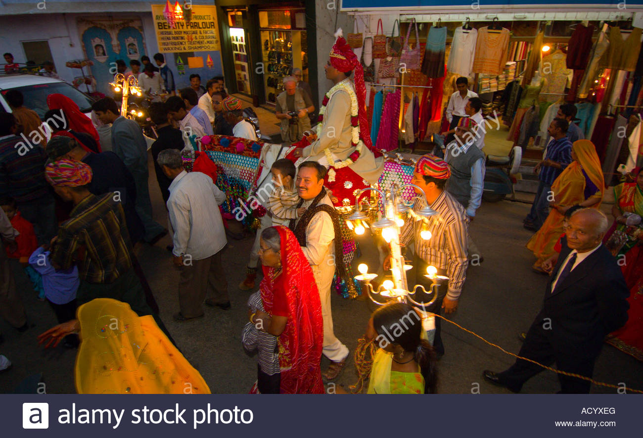 Bride groom riding a horse in a wedding procession in udaipur bride groom riding a horse in a wedding procession in udaipur rajasthan india junglespirit Images