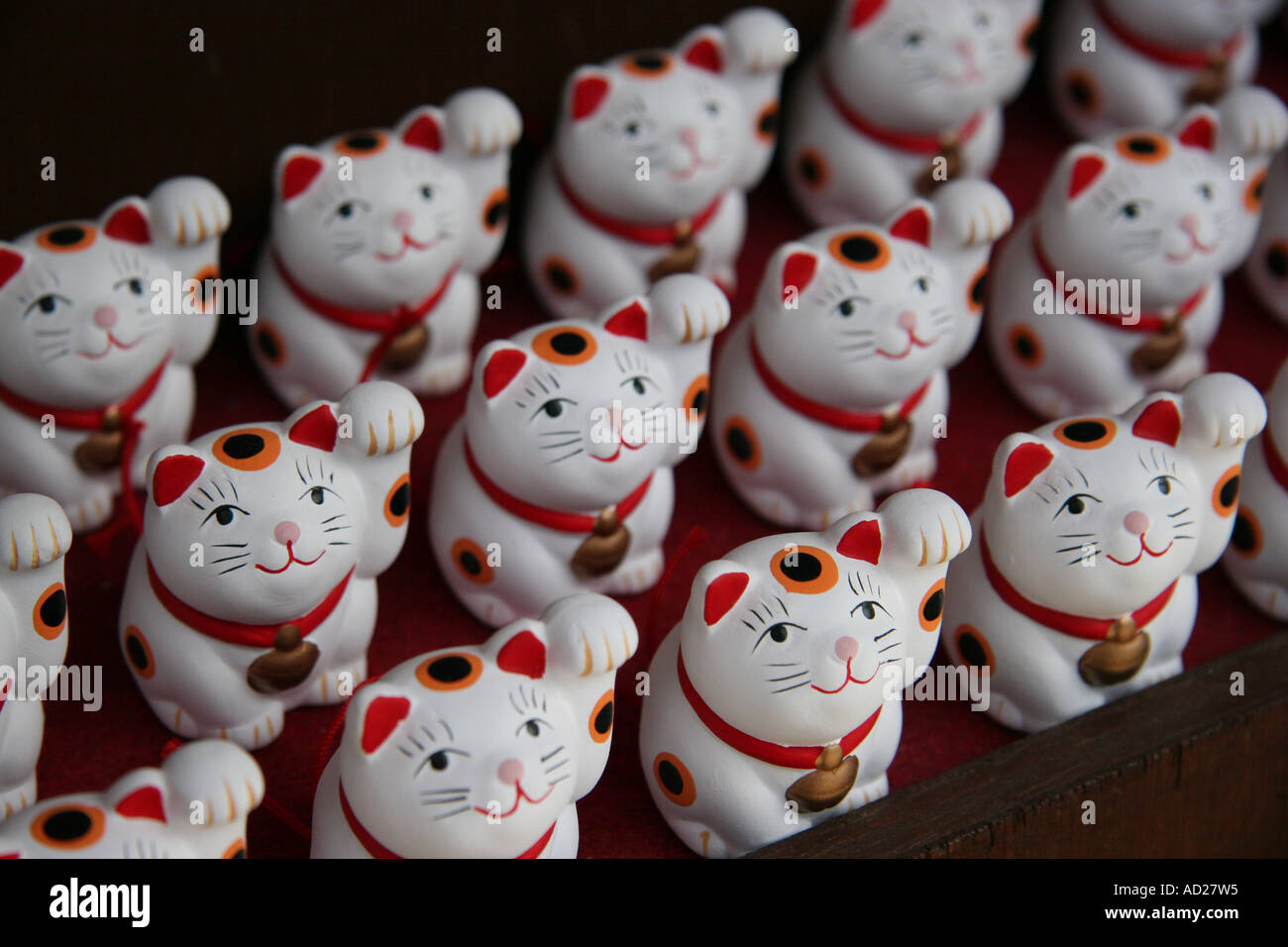 Miniature lucky cats for sale in Japan Stock Royalty Free
