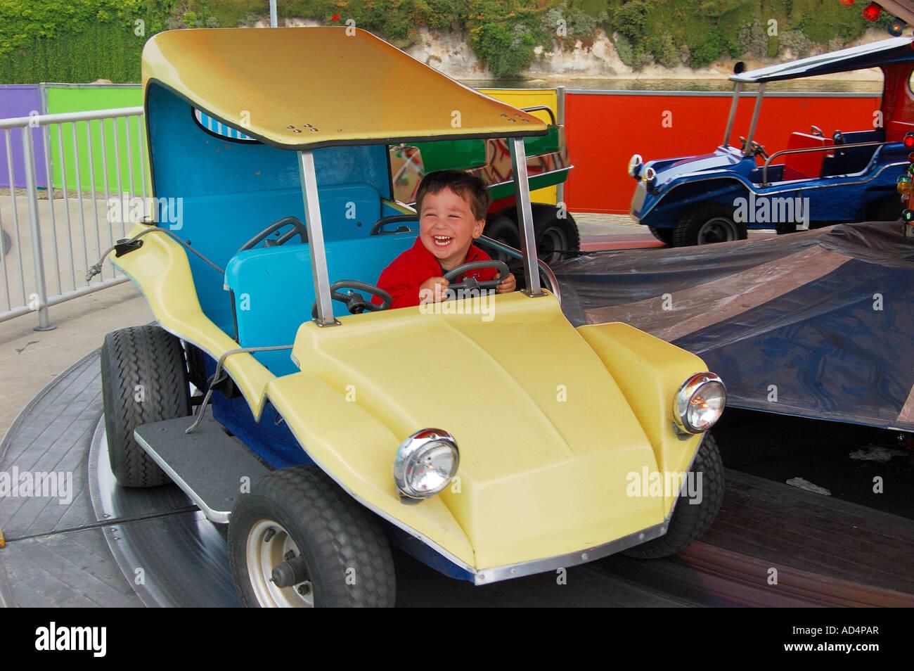 Two year old Nathaniel Bonomi rides the games at the Santa Cruz ...