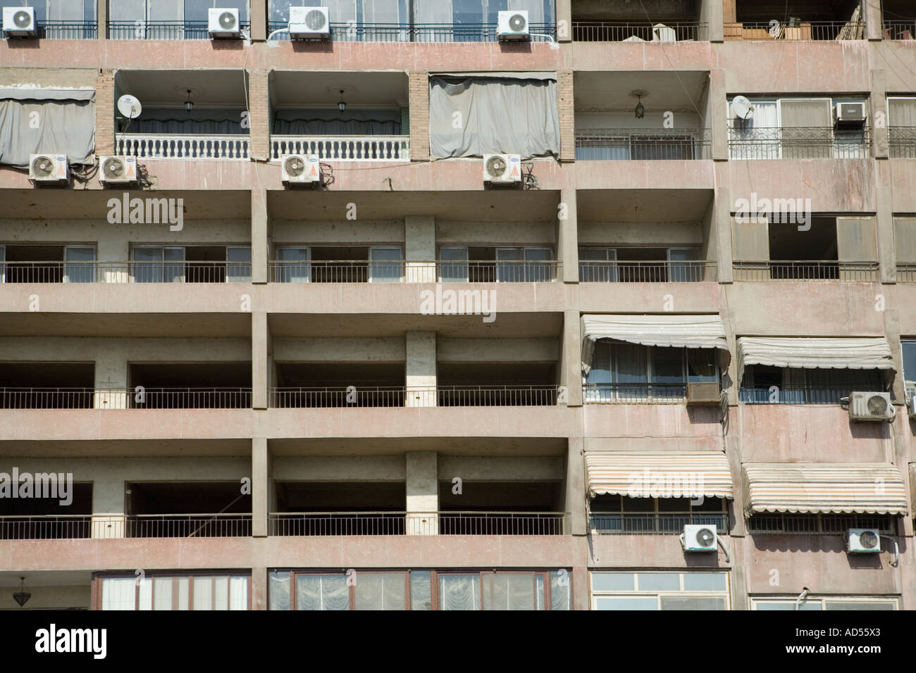 close up of apartment block balconies with washing and air