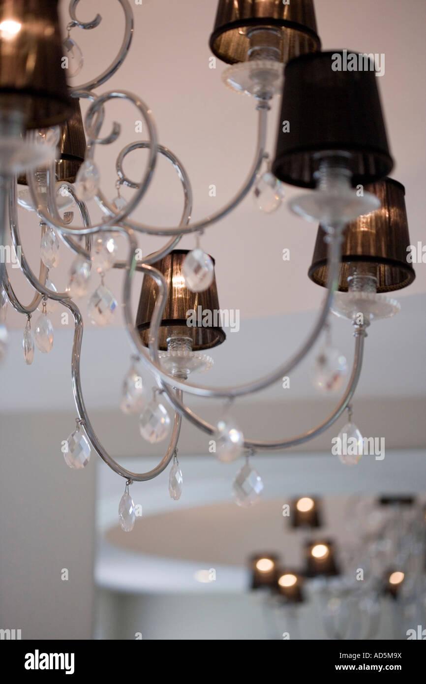 Close up of modern stainless steel chandelier with brown lampshades close up of modern stainless steel chandelier with brown lampshades and glass teardrops arubaitofo Gallery