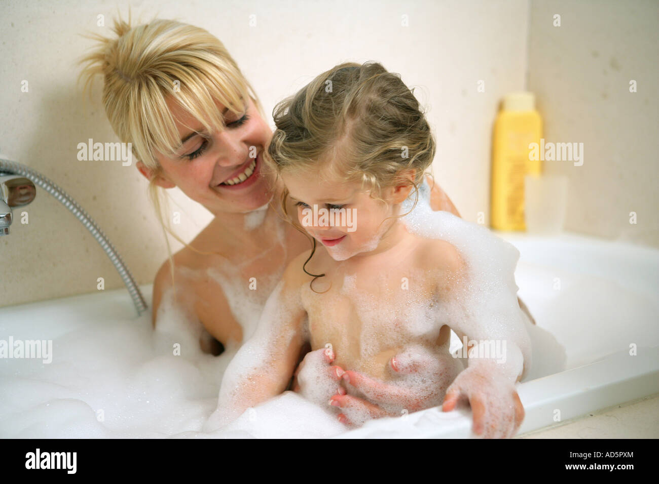 mother and child taking a bath stock photo royalty free