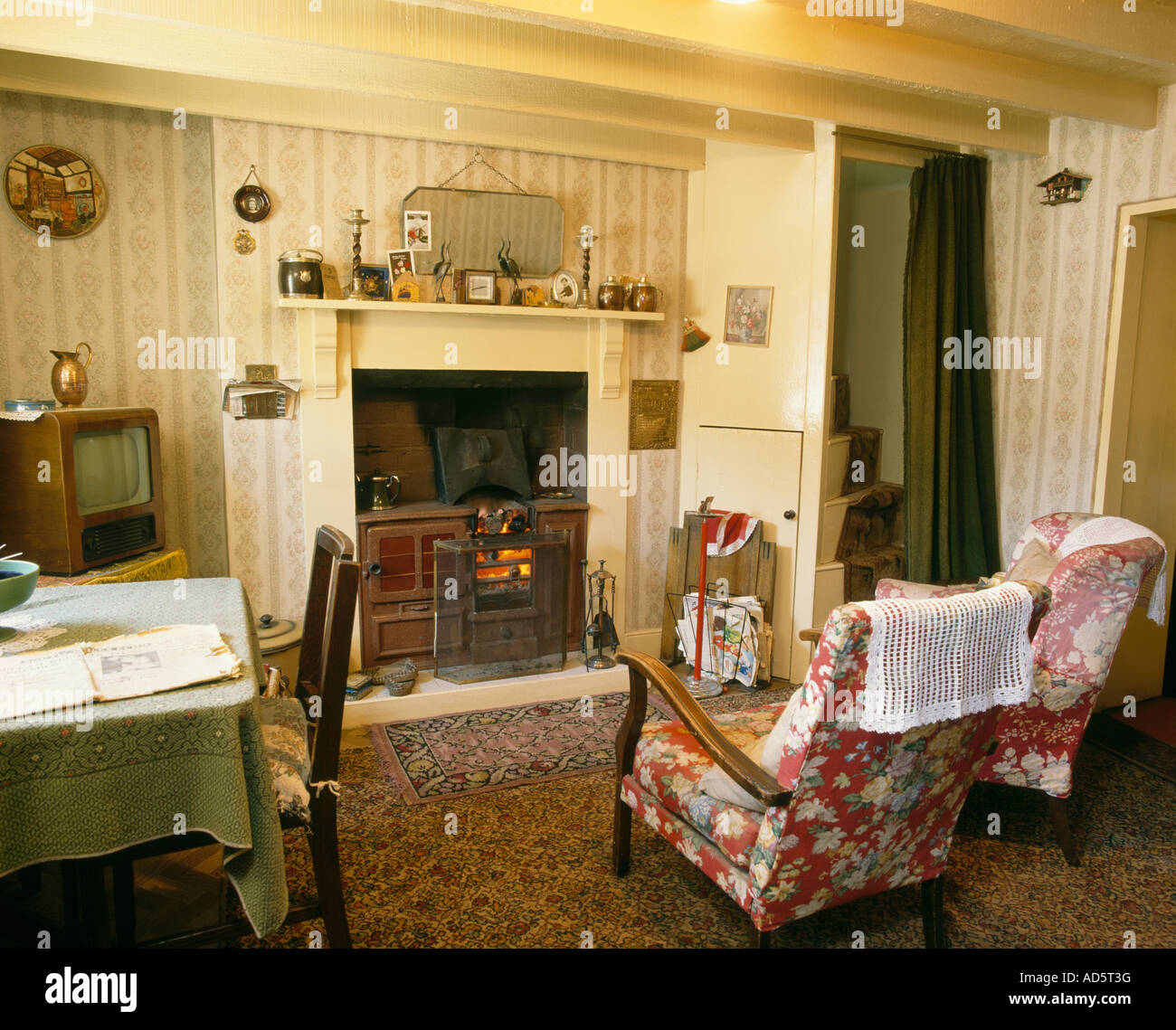 Floral Patterned Chairs In Front Of Fireplace In Fifties
