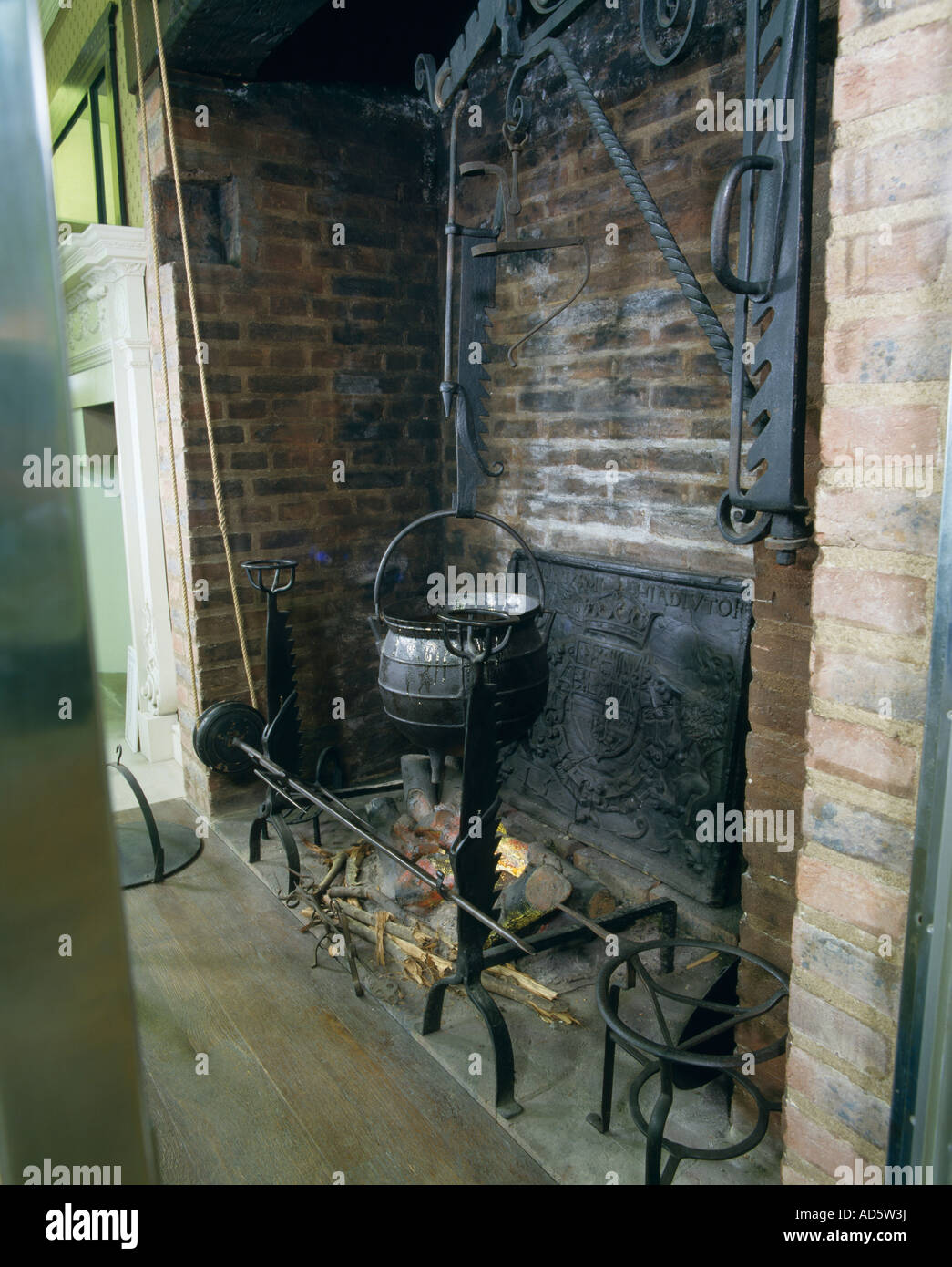 Cast iron pot with pulley system in large fireplace in old kitchen ...