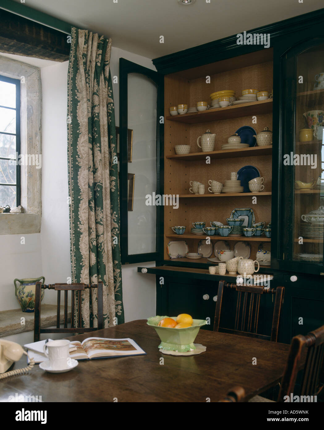 Large Antique Dresser With Crockery On Shelves In Country Diningroom Cup And Book Dining Table