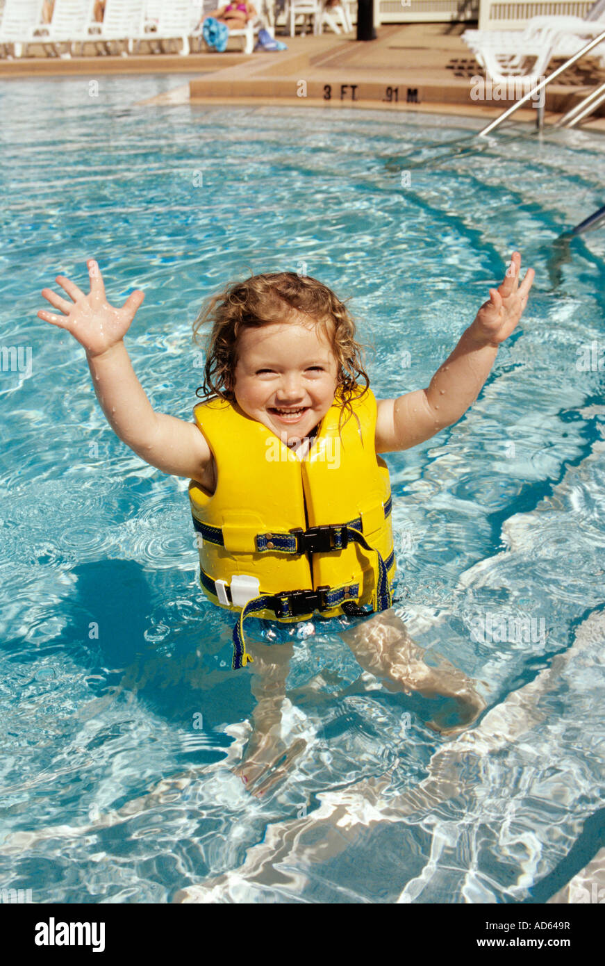 Young Girl In Swimming Pool Wearing Life Vest Stock Photo Royalty Free Image 13316914 Alamy