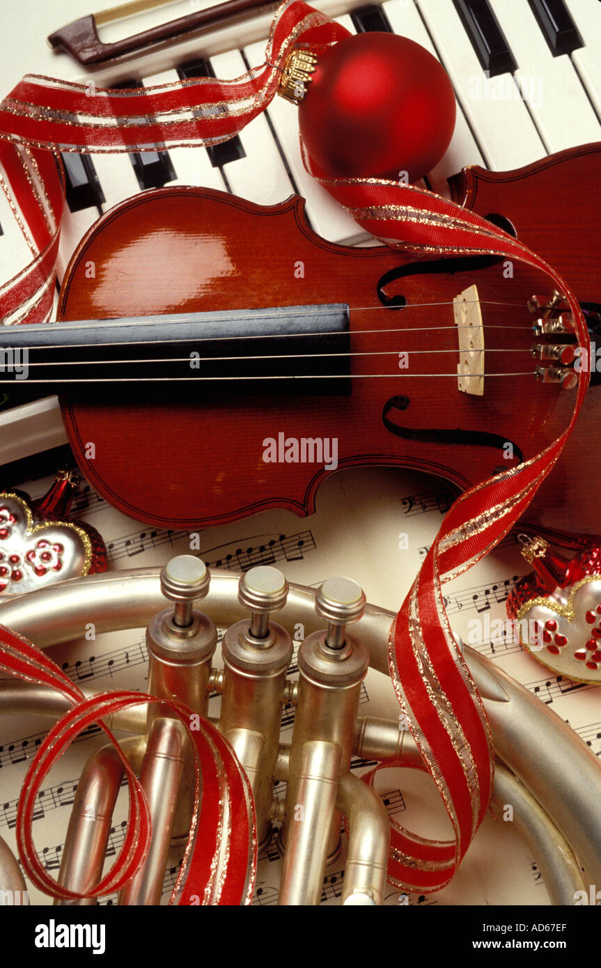 Violin christmas ornaments - Christmas Still Life Keyboard Violin French Horn Ornaments And Ribbon
