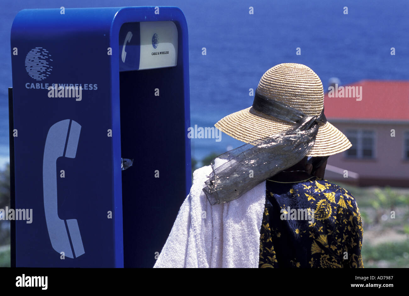 CARIBBEAN BRITISH WEST INDIES BARBADOS LA BARBADE THE BAJAN PEOPLE WOMAN AT PHONE BOOTH