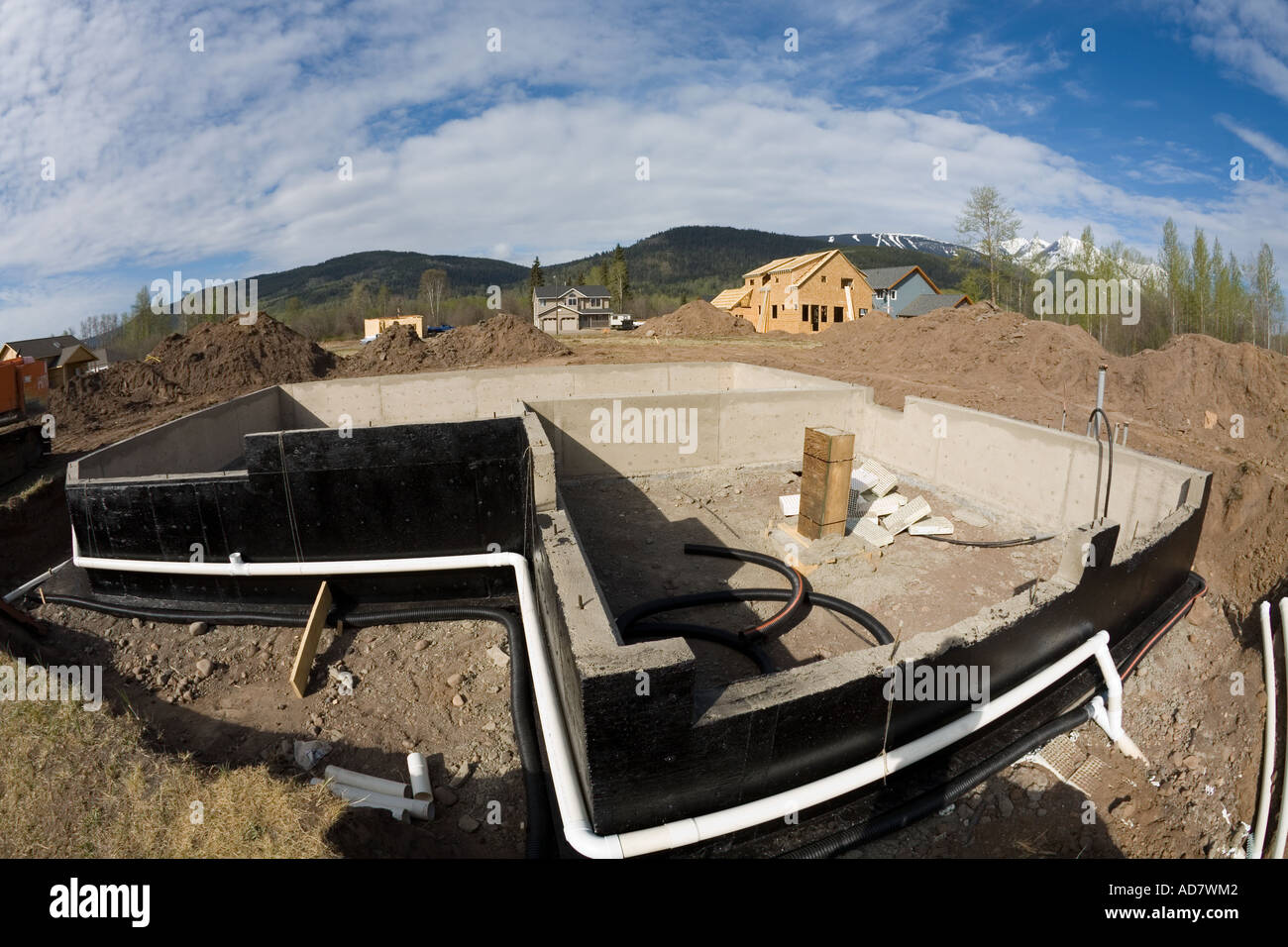 new home foundation in subdivision smithers bc stock photo