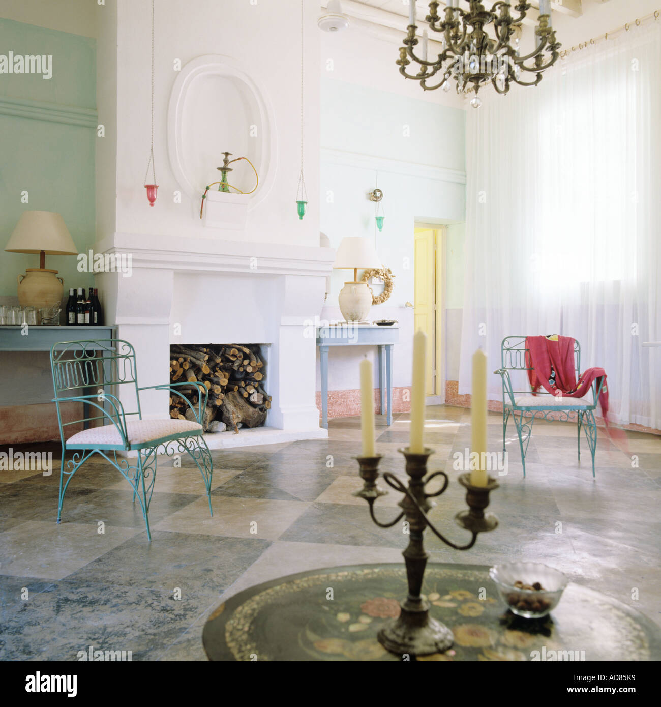 Charming Candelabra On Round Table In Entrance Hall With Checkered Marble Floor