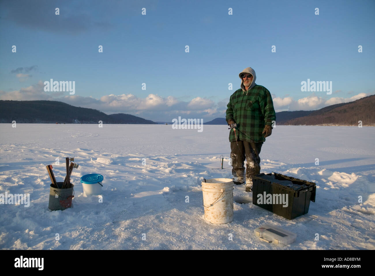 Ice fishing on otsego lake cooperstown new york stock for New york fishing