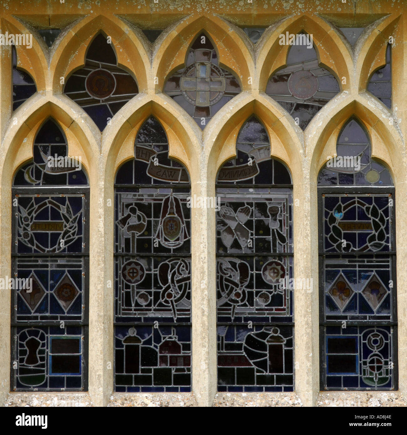 Mullioned Church Windows With Stained Glass Viewed From Outside