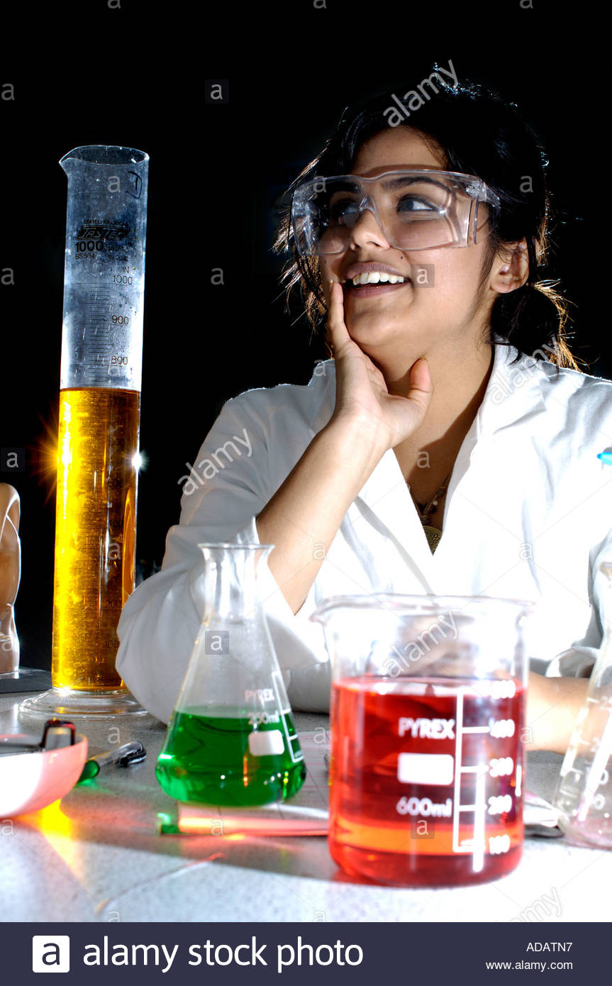Girl Scientist In Goggles And White Lab Coat Uk Stock Photo