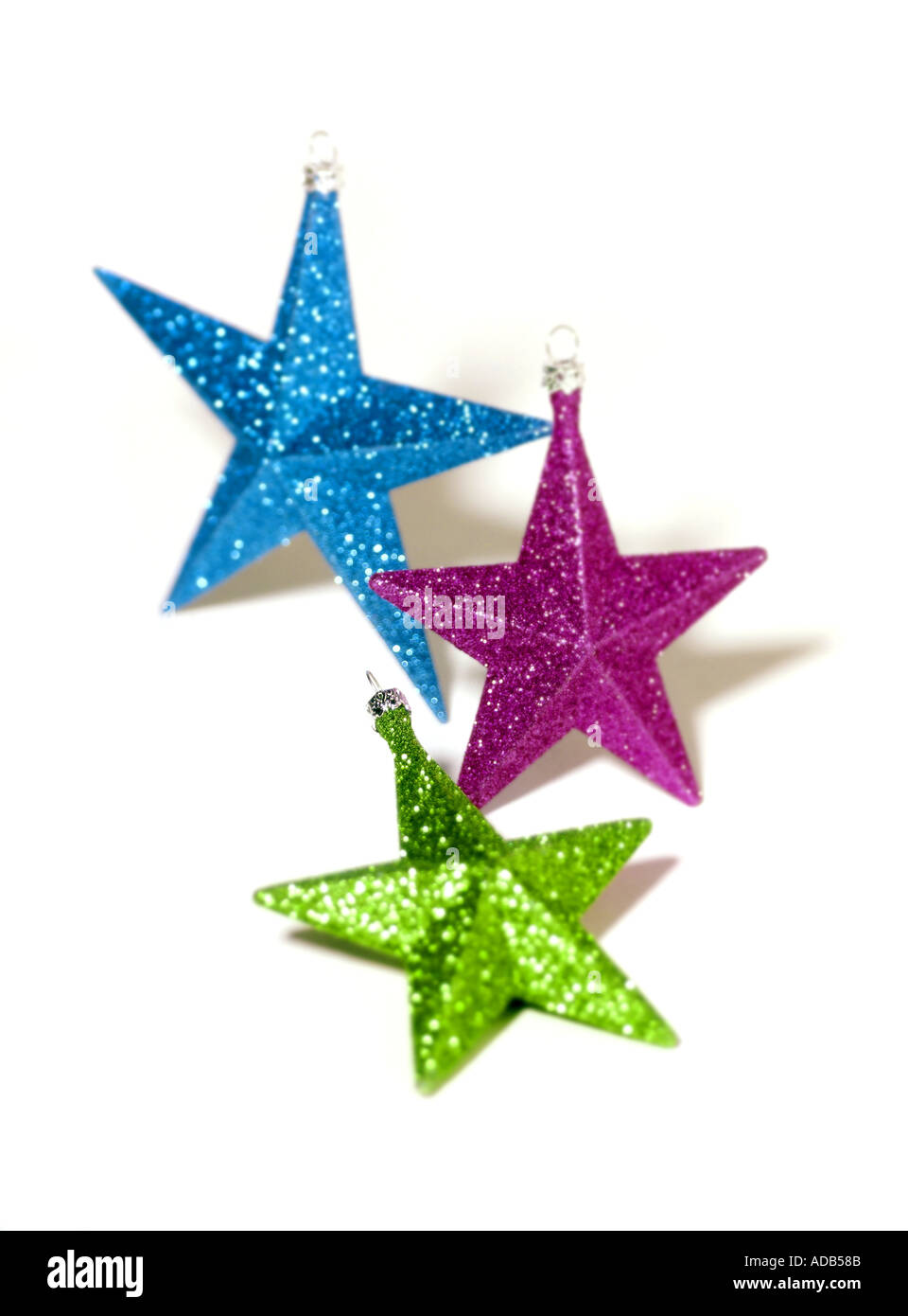 Green blue and purple star christmas tree decorations on