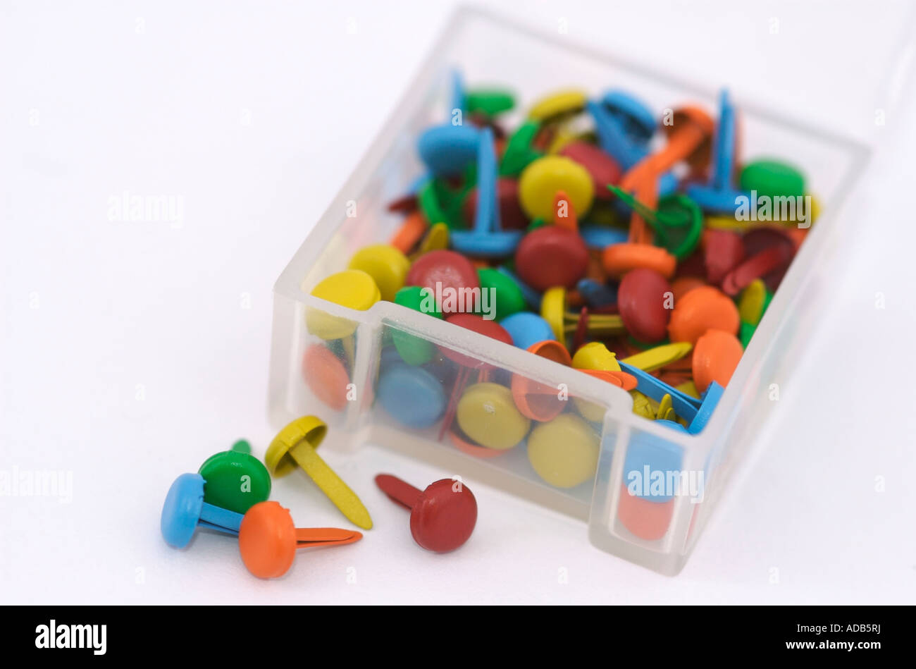 Box of coloured brads paper fasteners used in scrapbooking and box of coloured brads paper fasteners used in scrapbooking and other paper crafts jeuxipadfo Images