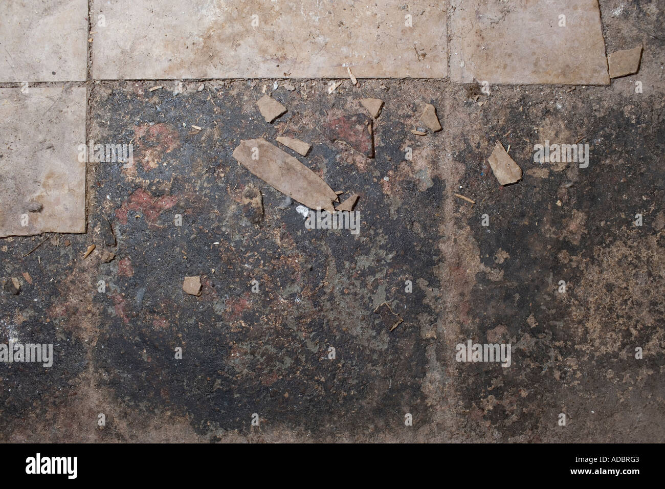 Asbestos tile in basement floor crumbling stock photo for Crumbling concrete floor