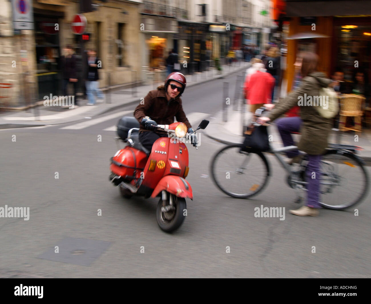 man riding his red classic vespa scooter in the le marais quarter stock photo royalty free. Black Bedroom Furniture Sets. Home Design Ideas