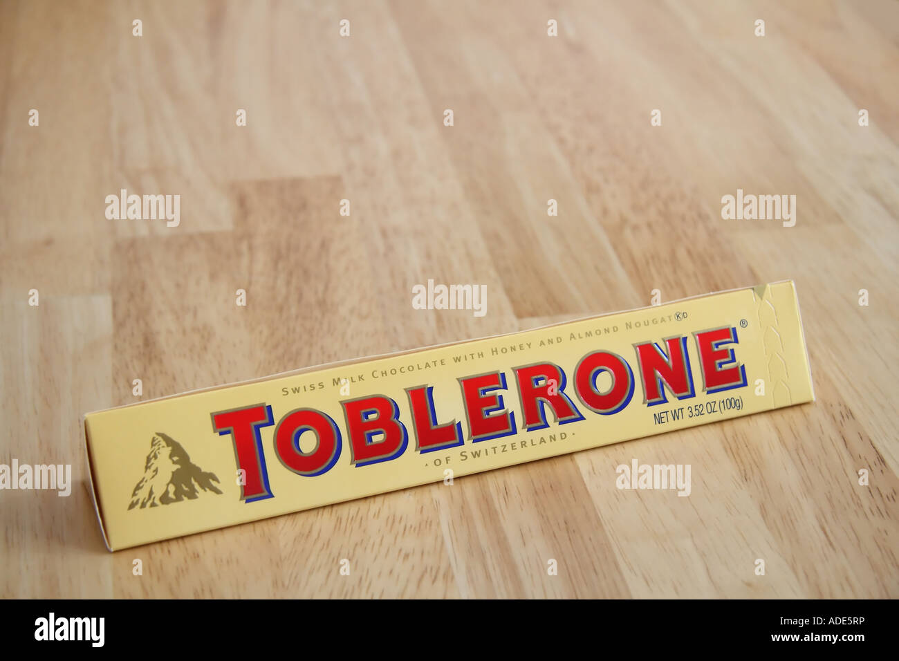 A Toblerone Swiss milk chocolate bar with honey and almond nougat ...