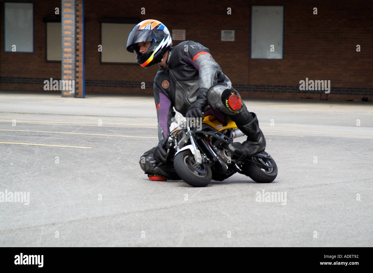 mini moto racing in a car park stock image