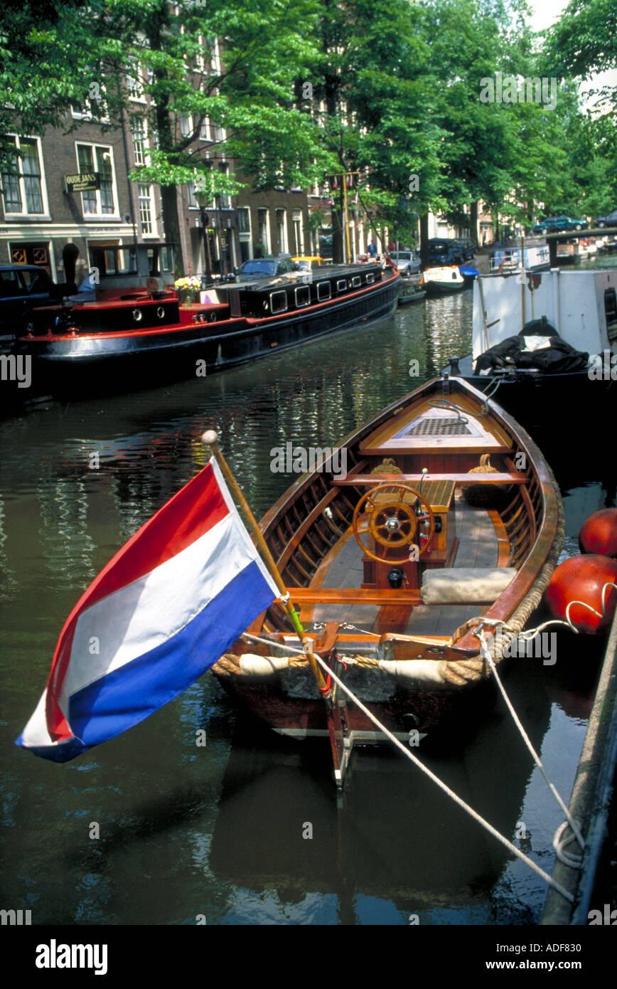 netherlands holland amsterdam canal boat flag of netherlands stock