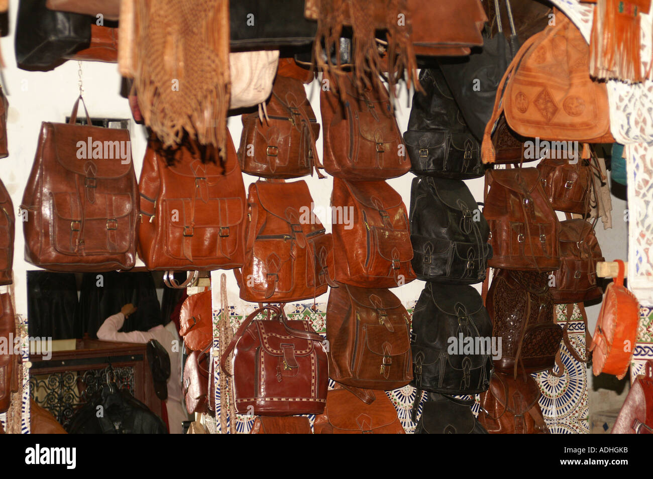 Leather bags and handbags hanging in a shop in the Souk Fes ...