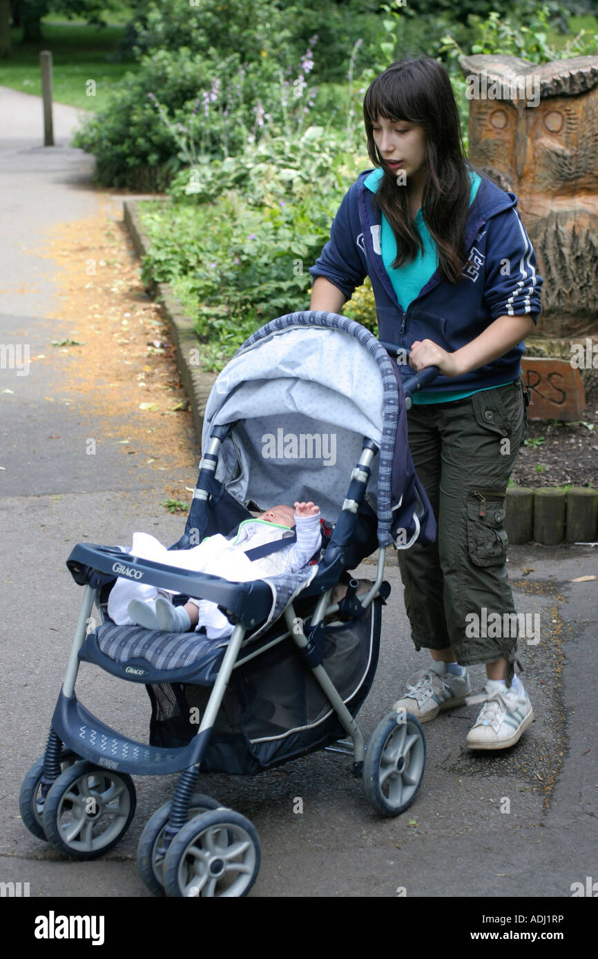teenage girl pushing 3 week old baby in pushchair wales uk. Black Bedroom Furniture Sets. Home Design Ideas