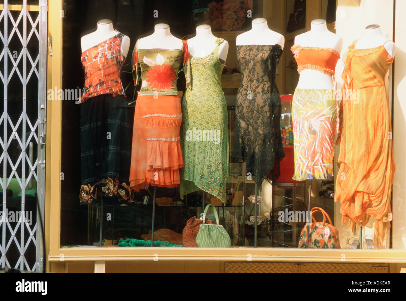 female women's dresses in boutique shop display window in new york ...