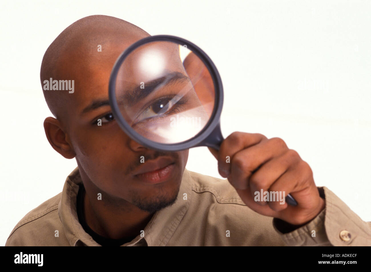 African American Man Looking Through Magnifying Glass