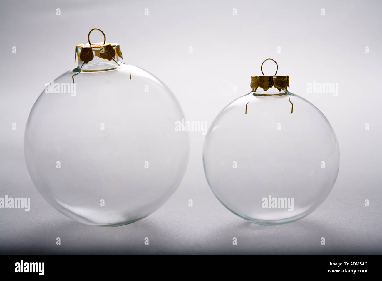 Large white christmas ornaments - Stock Photo Two Clear Christmas Tree Bulb Ornaments Large And Small On White Background Studio Portrait