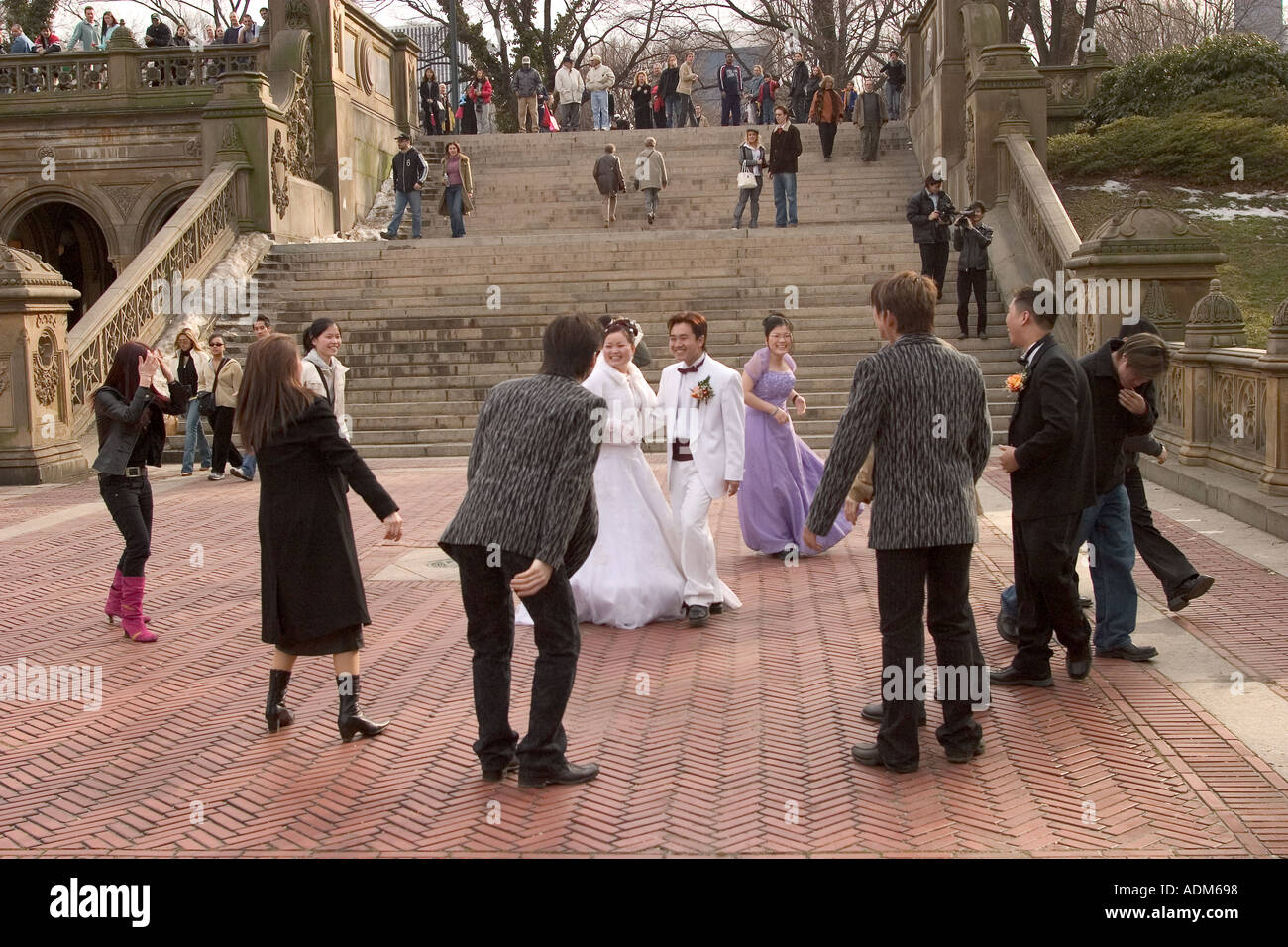 Members Of A Korean Wedding Party Dancing Near The Bethesda Fountain In Central Park Is Used As Backdrop For Ma