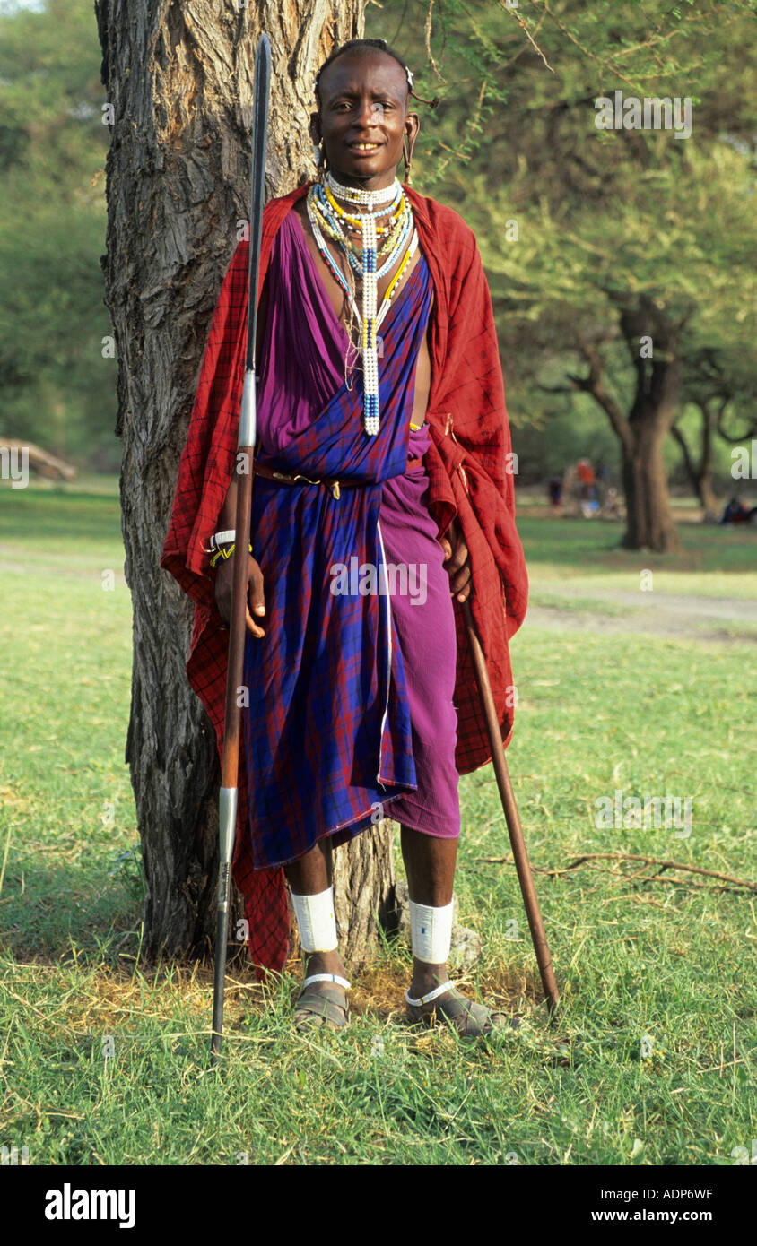 Maasai warrior in traditional dress in the african bush for Traditional photos