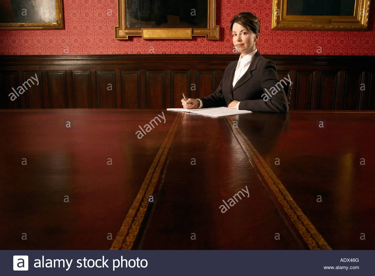 woman-in-conference-room-sitting-ADX46G.