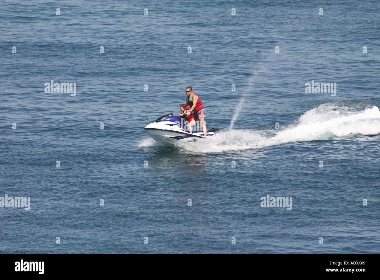 Two People On Jet Ski Bike In Bay At Palma Nova Stock Photo