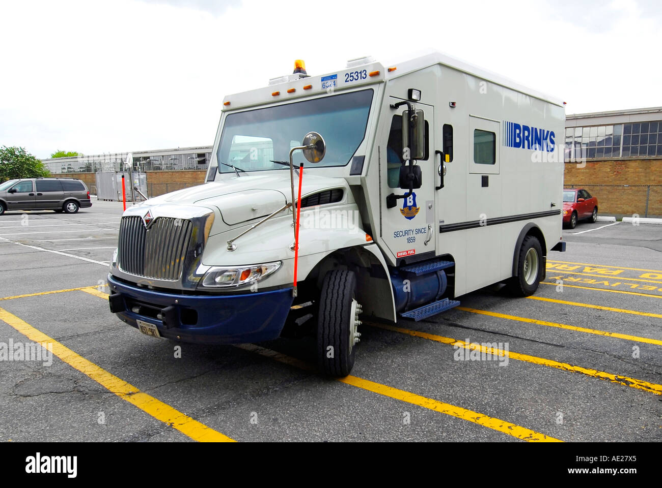 Brinks Armored Truck picks up and delivers cash money to banks and ...