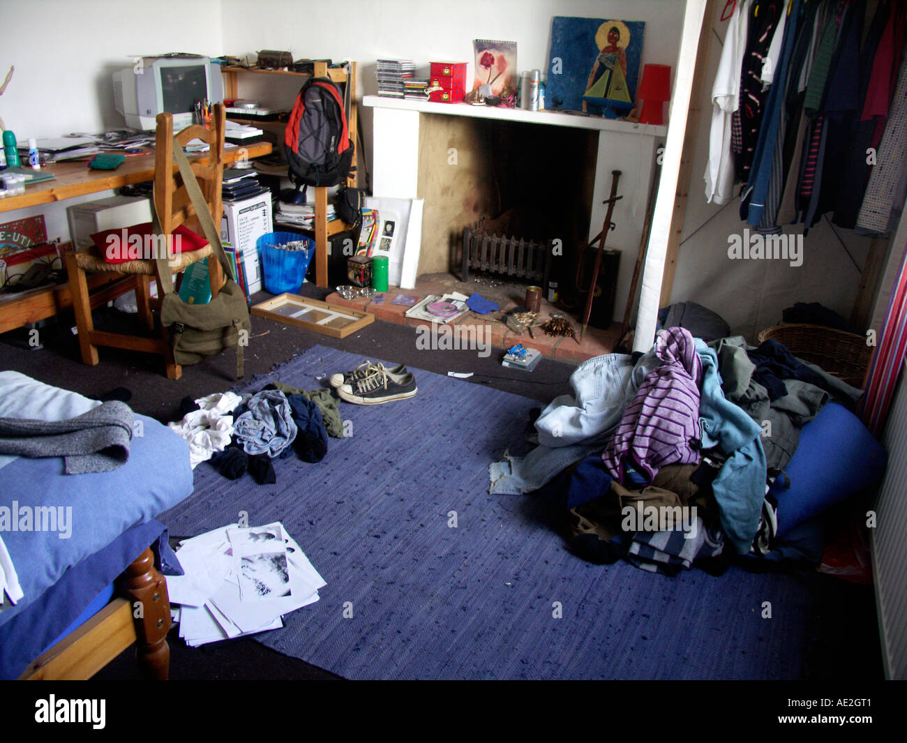 Messy piles of clothes in teenage boy's bedroom Stock ...