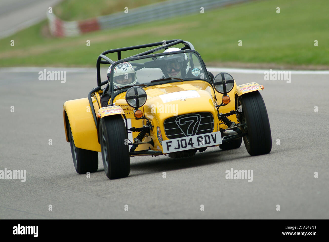 Lotus 7 kit car usa - Yellow Caterham Lotus 7 Sports Car On Race Track In The Uk Stock Image