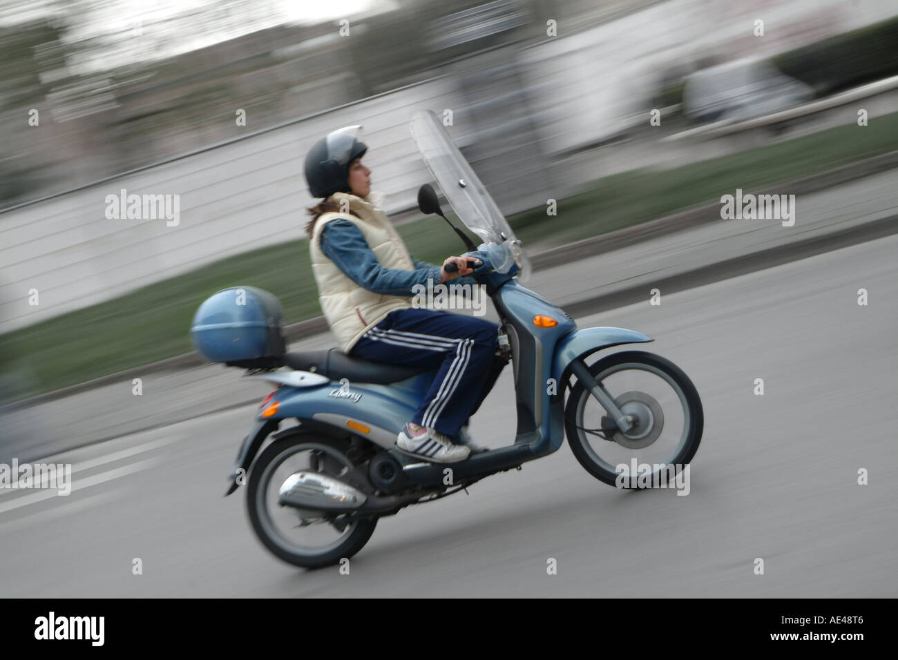 person riding a city scooter, piaggio liberty, on the streets of