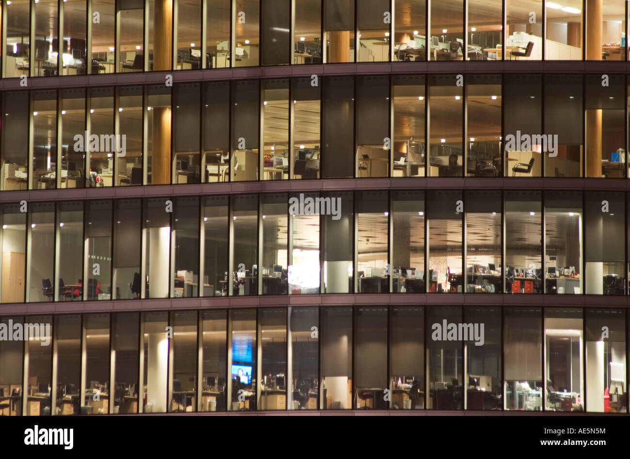 Window at night from outside - Several Floors Of Office Building Seen From The Outside Through Glass Windows At Night Stock