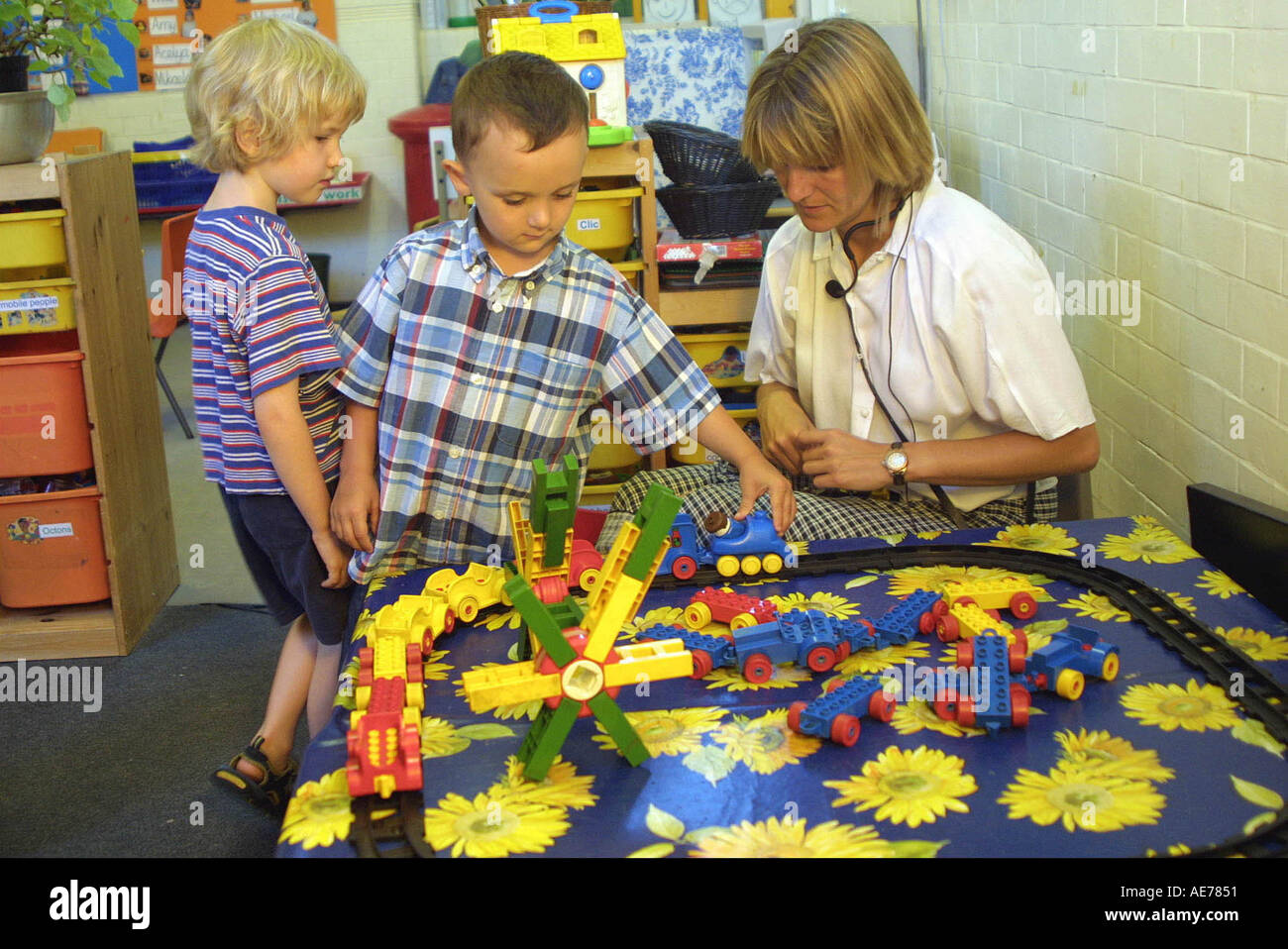Kinder Garden: Nursery School Children Playing With Toy Lego Stock Photo