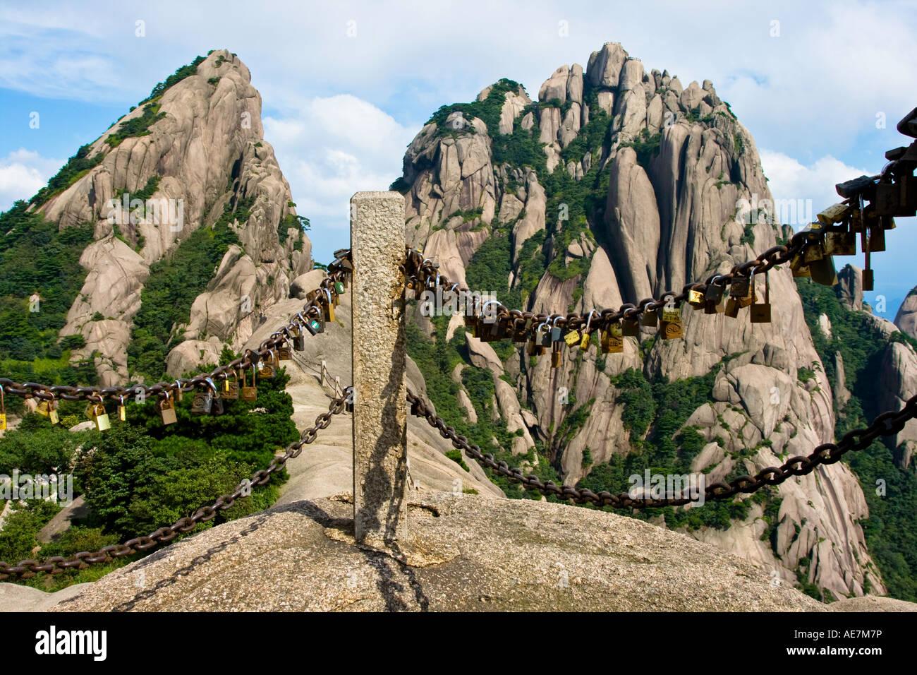 Stock Photo - Lovers Locks in front of Lotus Peak Huangshan Mountains ... Yellow