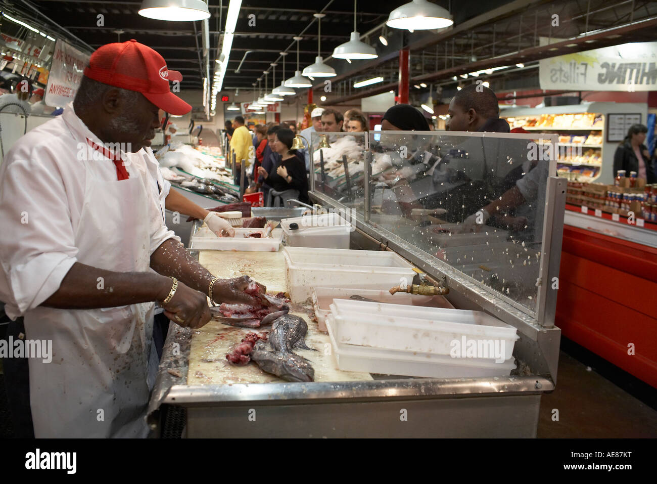 Man scaling fish wholey s market pittsburgh pa usa stock for Wholey s fish market