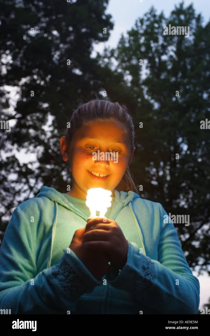girl-holding-a-fluorescent-energy-saver-